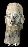 ******** Painted terracotta head from a statue of a worshipper