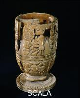 ******** A carved ivory cup made by acraftsman from Owo a Yoruba city-state roughly halfway between Ifeand Benin. Its art shows link toboth these cultures.