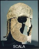Celtic art Vendel warrior's helmet.  The  cheek guards  are of iron while the cap is covered by bronze sheets  portraying a procession of warriors.