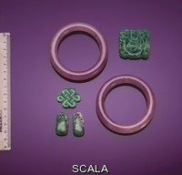 ******** A group of jadeite jewellry including an antique pendant depicting a nesting bird, a plaque carved as an endless knot, two green pendants, circa 1900 and a pair of smoky lavender jade bangles.