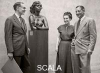 ******** Alfred H. Barr, Jr., Director of the new Department of Museum Collections, with Curator Dorothy C. Miller and James Thrall Soby, Chairman of Painting and Sculpture, n.d. (late 1940s). On the stand a sculpture by Jacob Epstein