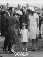 ******** The Queen shaking hands with young John Kennedy, Runnymede, near Windsor, Berkshire, 1965.