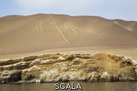 ******** A symbol called the Candelabra of Paracas etched into a sand hill. Ballestas Islands, Paracas, Peru.