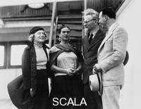 ******** Leon Trotsky with his wife Natalia Sedova and Mexican artist Frida Kahlo, 1937. Trotsky (1879-1940) was one of the leading figures of the Russian Revolution and in the Soviet government afterwards. He lost out to Joseph Stalin in the power struggle that took place at the top of the Communist Party after the death of Lenin and was expelled from the Party on 12 November 1927. In January 1928 he was exiled to Alma Ata, today in Kazakhstan, and the following year was banished from the Soviet Union altogether. Trotsky married Natalia Sedova (1882-1962) in 1903. She accompanied him into exile. In 1937, after periods living in Turkey, France and Norway, the couple moved to Mexico, where they initially moved in with Kahlo (1907-1954) and her husband, Diego Rivera. During this period Trotsky had an affair with Kahlo. In 1940 he was assassinated by
