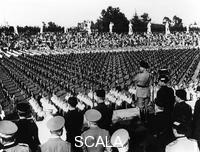 ******** The Duce Observing the well ordered lines of young Balillas at the Stadio dei Marmi in Mussolini Forum. To the right the secretary of fascist party Achille Starace. Rome, 24.05.1934.