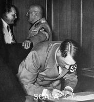 ******** Hitler signing the Munich Pact, 30.09.1938. Behind him Goering and Mussolini