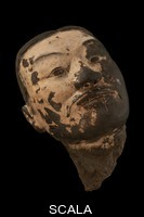 ******** The painted face of a terracotta soldier excavated from Xian's most famous site, known as Pit 1. Xi'an, Shaanxi Province, China.