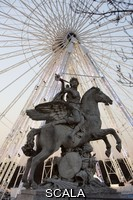 ******** La renommee montee sur Pegase, marble, 1668-1702, equestrian statue by Antoine Coysevox, Lyon 1640 - Paris 1720, placed at the Tuileries in 1719, exposed at Louvre Museum, great wheel of La Concorde in the background, Paris, France Picture by Manuel Cohen