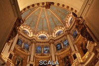 ******** Inside the cupola of the capilla mayor of Granada Cathedral, or the Cathedral of the Incarnation, built 16th and 17th centuries in Renaissance style with Baroque elements, Granada, Andalusia, Southern Spain. The dome is painted with a starry sky and there are 2 levels of 16th century stained glass windows above a series of paintings by Alonso Cano. Granada was listed as a UNESCO World Heritage Site in 1984. Picture by Manuel Cohen