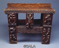 ******** Nigerian School (20th century). A rare Owo rectangular seat. 1908-10.