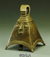 ******** Nigerian. An Owo brass bell of pyramidal form with a human face in relief. 14.6cm high.