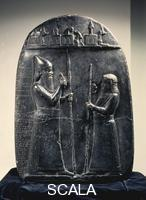 ******** Kudurru (boundary stone) of King Marduk-aplaiddina II. 721-711 BCE. The king is on the left, at right a temple official.