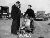 ******** Stirling Moss on a Vespa scooter, Goodwood, April 1952.
