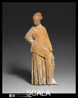 ******** Terracotta statuette of a standing woman, late 4th-early 3rd century b.C.