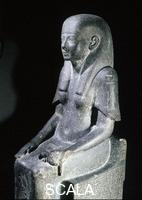Egyptian art Seated statue of the Princess Shebensopdet granddaughter of Osorkon II. A systrum-player of Amun this statue was commissioned and placed in the temple of Amun at Karnak by her husband the scribe Hor following her early death.Side view.